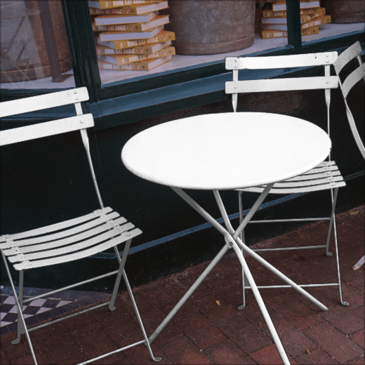 Coffee Cup by Albany on a metal table and chairs