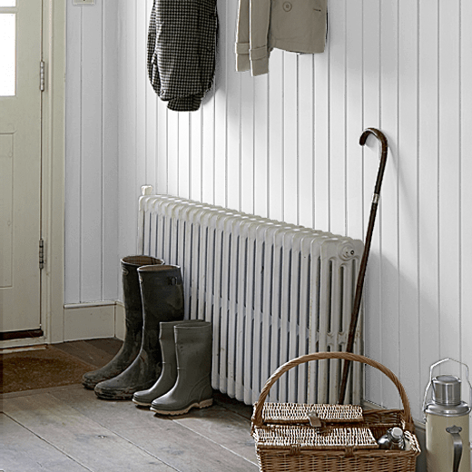 Airlane Blue by Sanderson on a wood panelled hallway wall