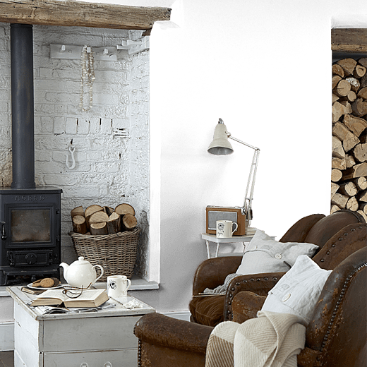 Oxney Olive by Sanderson on a lounge wall