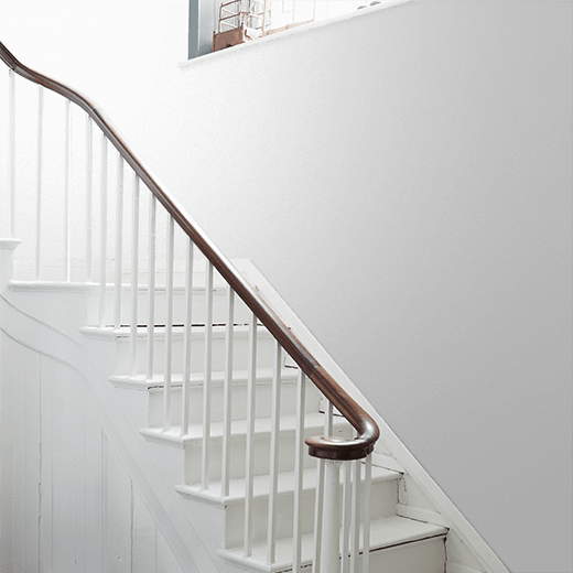 Acorn Mid by Little Greene Green on a stairway wall